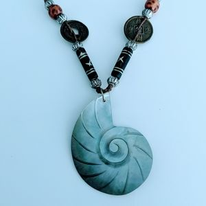 Spiral shell bead and leather necklace, pendant